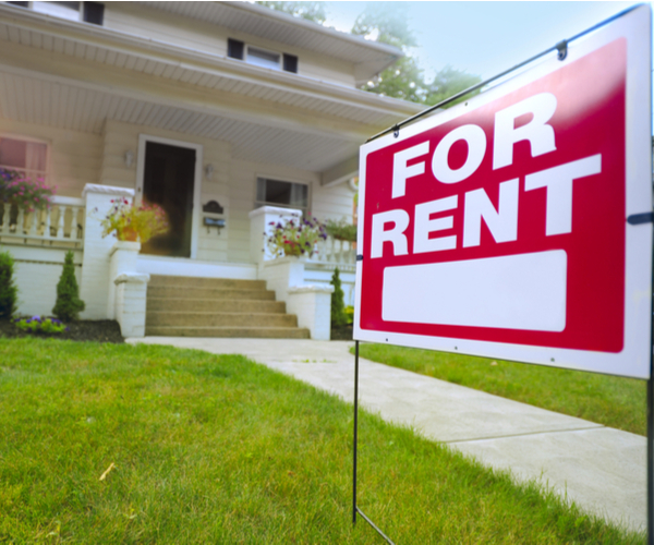 House with Signage outside of For Rent
