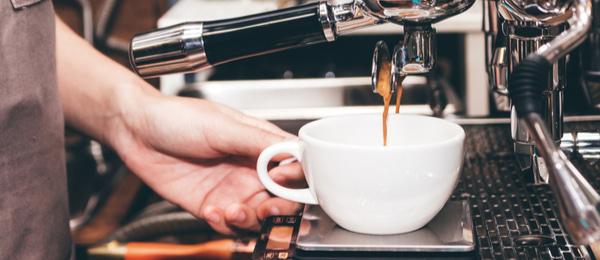 Barista using coffee machine