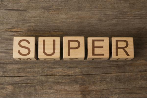 Super word written on wooden cubes
