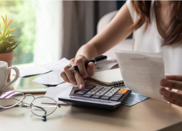 Woman using a calculator for computing her billing