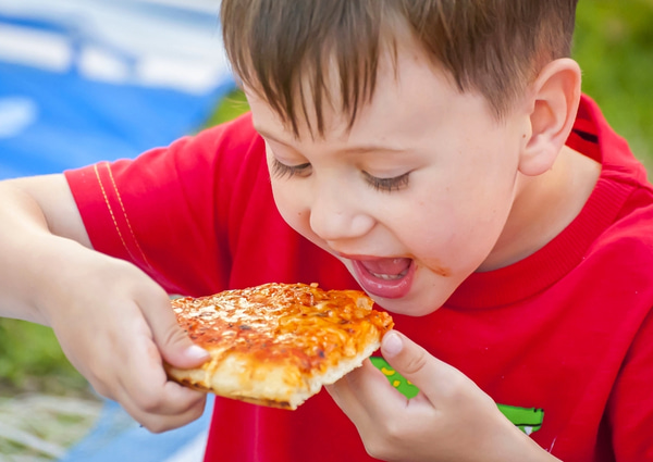 Little kid eating pizza