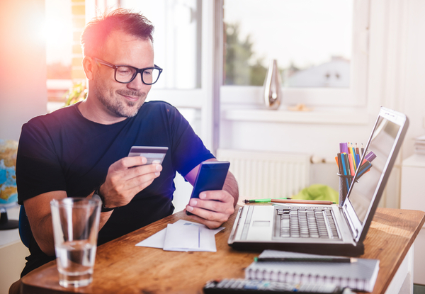 Man paying with credit card on smart phone