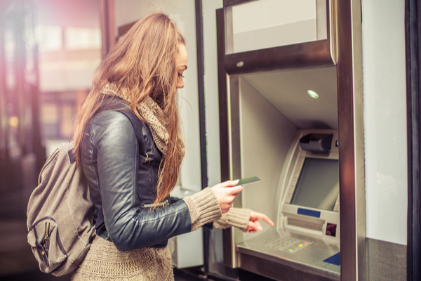 Woman withdrawing money form the machine