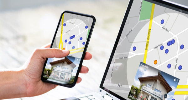 Woman searching for Real Estate online on mobile phone