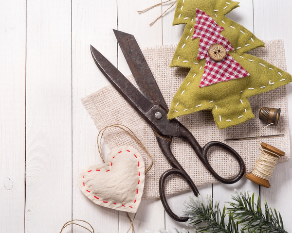 Vintage scissors surrounded by Christmas decorations