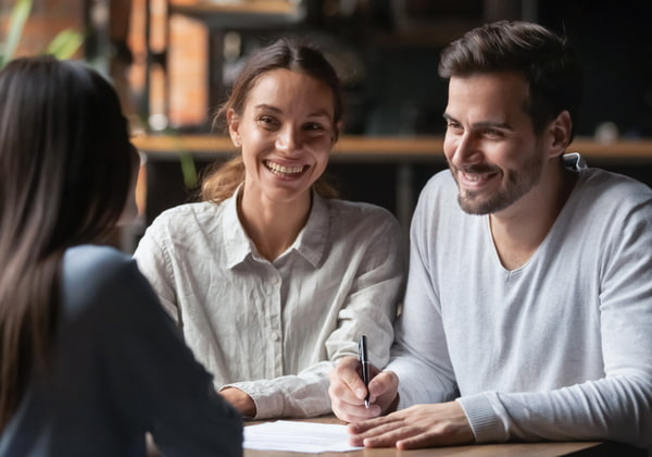 Young couple consulting agent