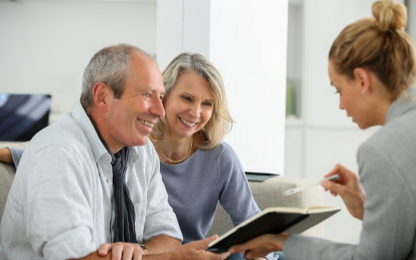 Agent selling life insurance to senior couple