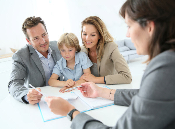Parents with young boy meeting with an agent