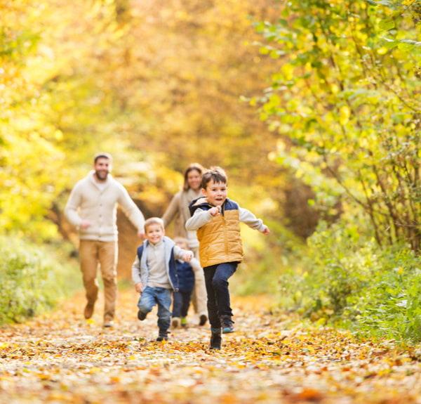 Family running at autumn park