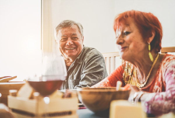 Happy mature people eating and laughing