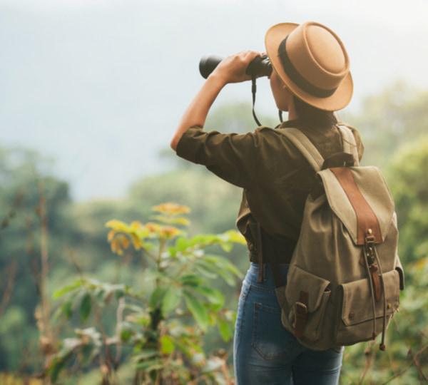 Woman using binocular