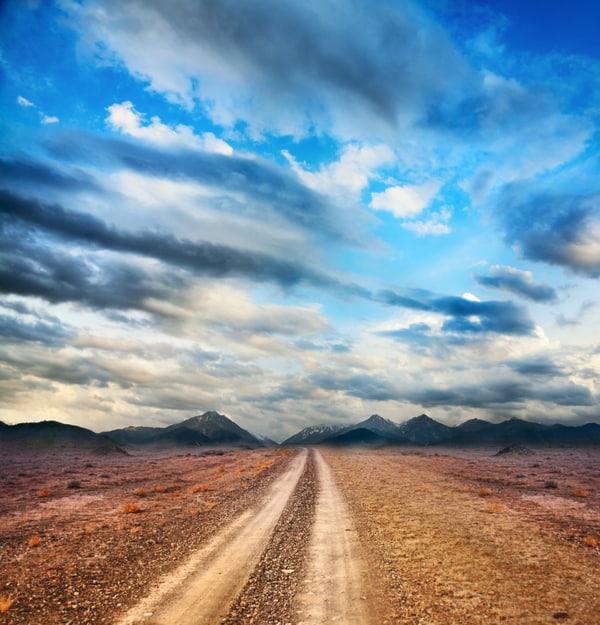 Road to the mountains through the desert