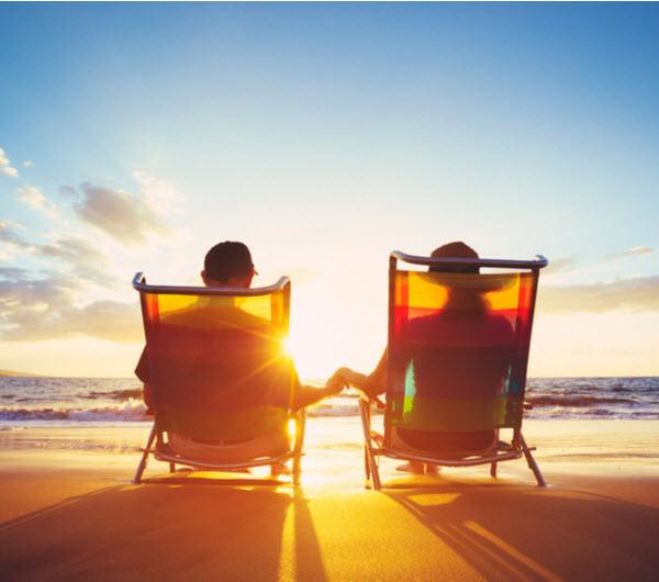 Couple enjoying the beautiful sunset at the beach